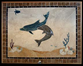 large splash mural of 2 dolphing playing over a reef