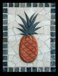 carved pineapple with green bourder