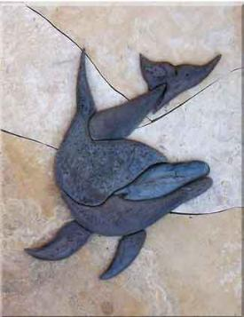 large carved dolphin mural in travertine