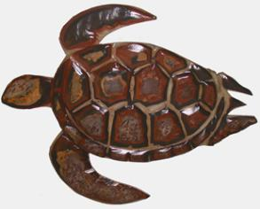 photo of a carved overlay turtle featuring red tones